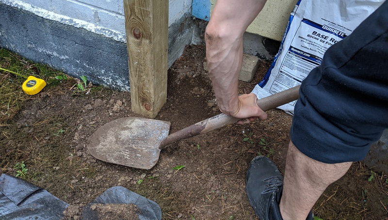 tamping dirt for fence post hole