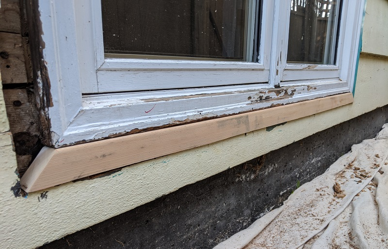 checking fit for replacement wood piece