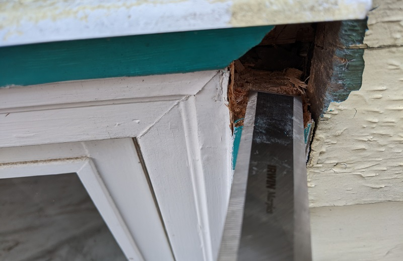 removing wood rot with chisel