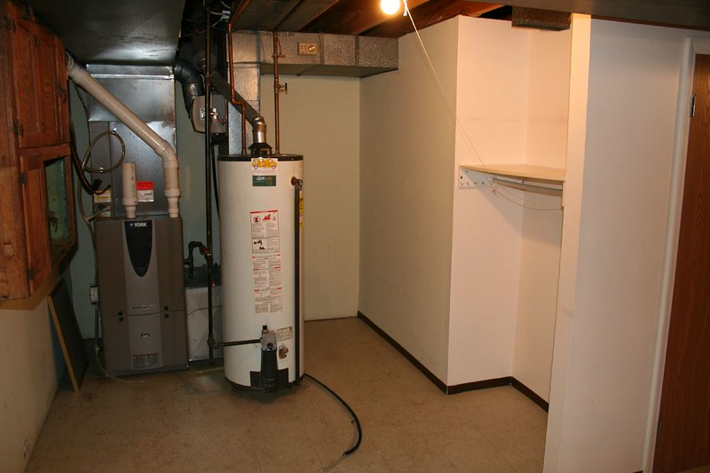 storage tank hot water heater in basement