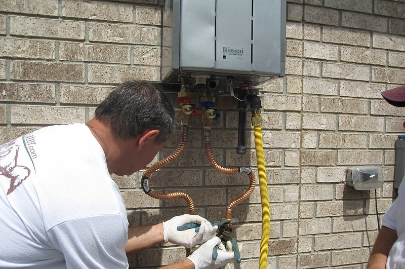 tankless water heater installed on home exterior
