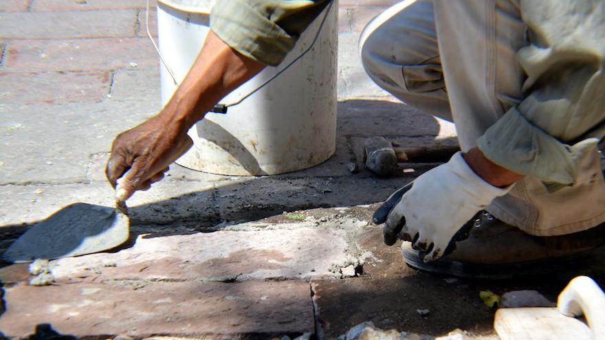 mason using mortar