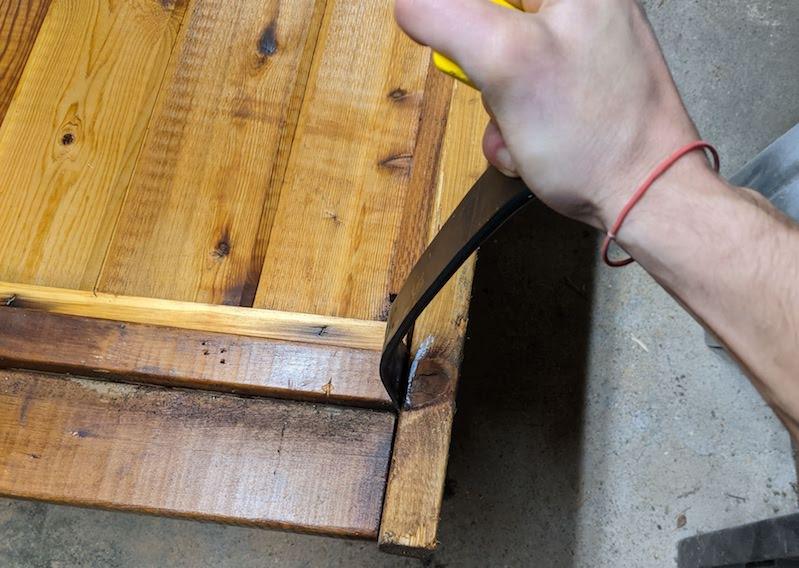 prying frame apart with prybar