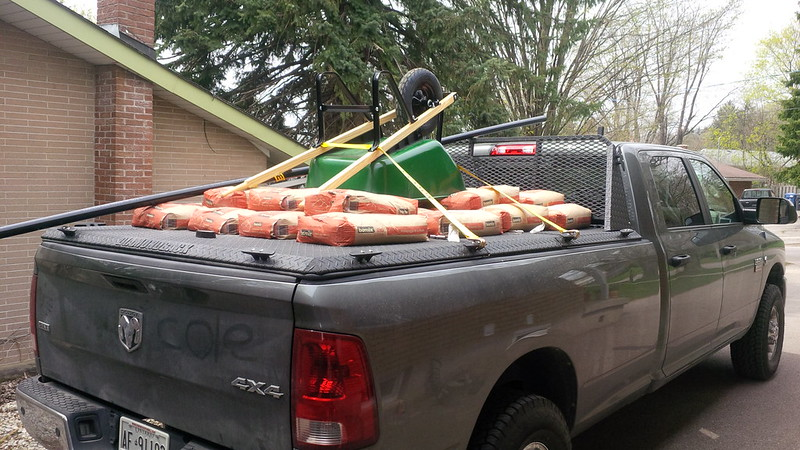 truck bed with concrete mix and wheelbarrow