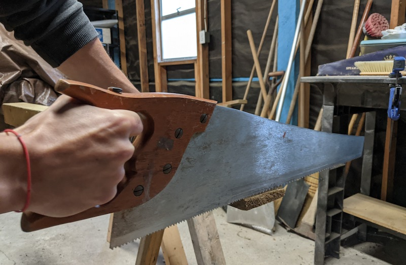 using a hand saw