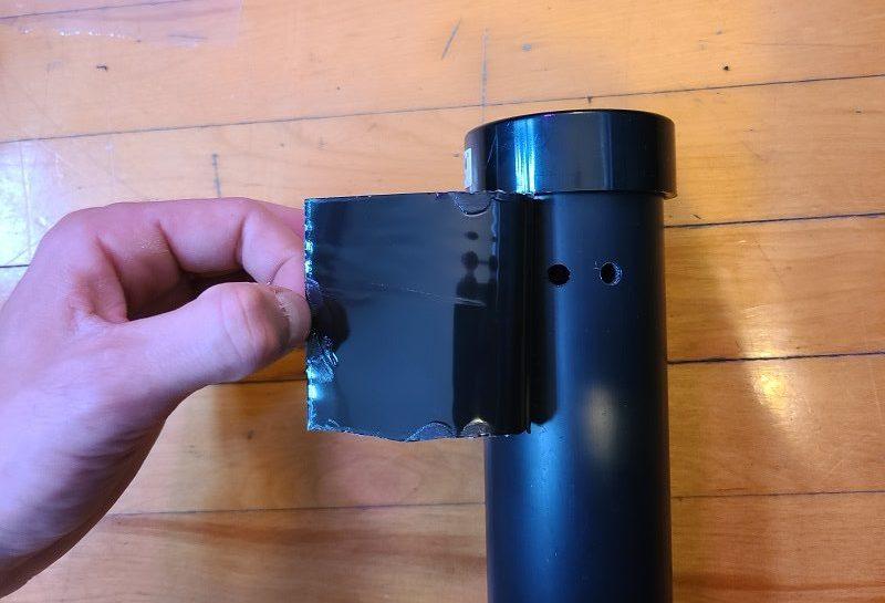 applying flex tape to pvc pipe