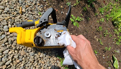 wiping chainsaw interior clean