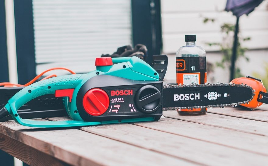 electric chainsaw with bar oil and ear protection