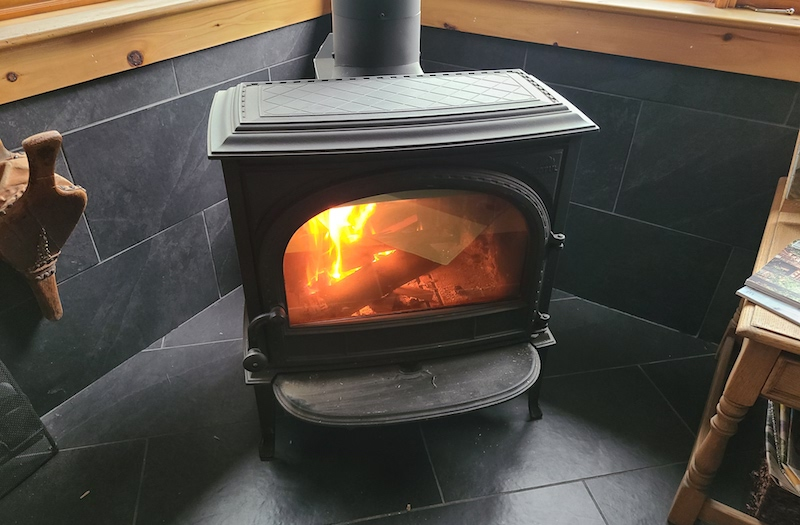 modern wood stove with fire burning
